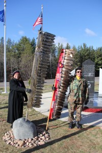 Sara Balbin and Gary Quarderer with LCO Veterans Eagle Staffs